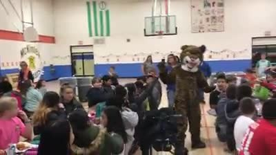 School mascot approaches boy and removes mask, he flips out when he sees who is inside