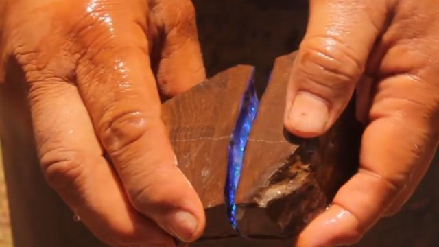 Miner cracks open stone to reveal stunning opal