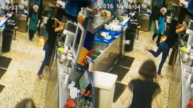 This lady surprised her customers when she did an impressive move to save a cup from falling on the