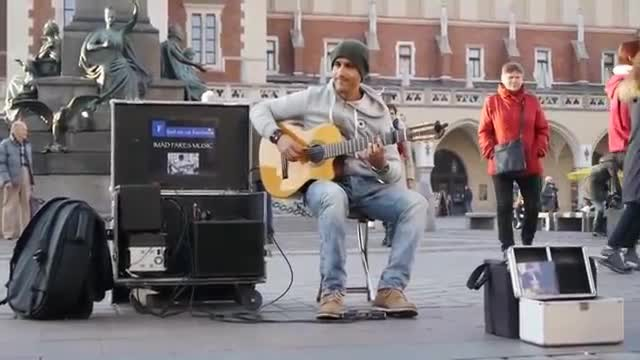 Guitarist sits to play in front of fountain - And his performance is getting millions of views