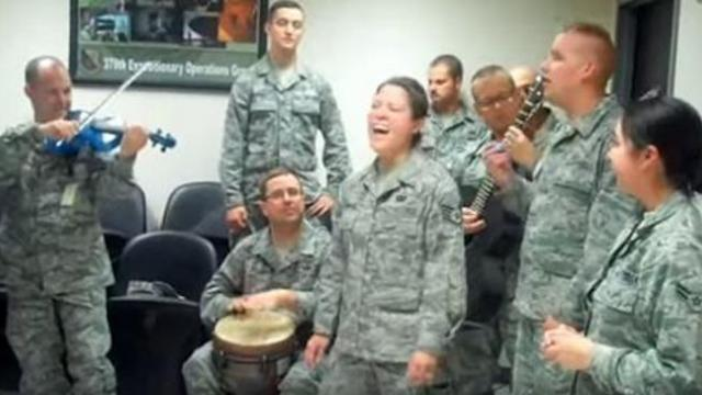 Deployed airmen gather to sing popular Adele song - at :26, they cover everyone in goosebumps