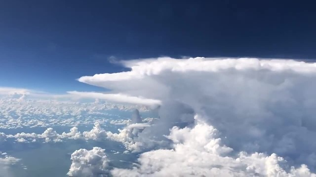 Plane passes massive storm cloud when passenger pulls out phone to capture heart racing sight
