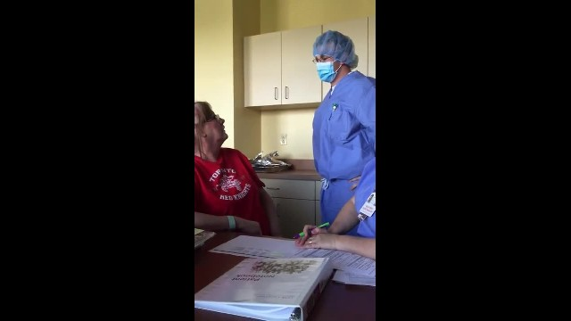 Mom learning about her chemo treatment breaks down when nurse removes mask