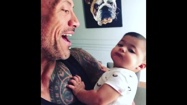 Dwayne Johnson holds little daughters while saying he will protect them for the rest of his life