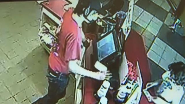 Security camera catches the moment a little boy gives the cashier a note and leaves everyone speechl