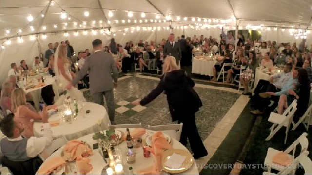 Bride & groom floored when country singer secretly shows up during first dance