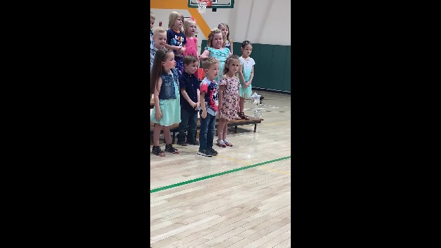 Four-year-old 'little patriot' nails national anthem performance at preschool graduation
