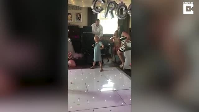 Brave six-year-old stands up at wedding and belts out a song that had everyone on their feet