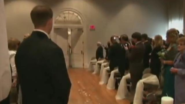 Paralyzed bride 'Walks' through the door as stunned guests break down weeping
