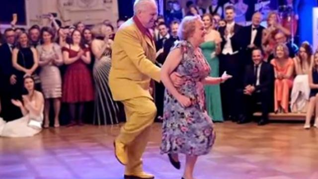 Elderly man in yellow sneaks up from behind with dance move crowd will never forget