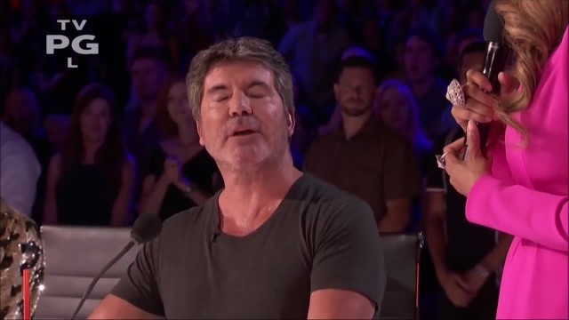 Simon's golden buzzer favorite takes stage moving him to tears when stirring voice makes him choke