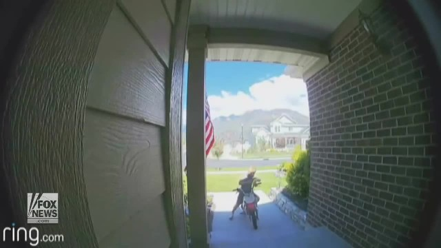 Security camera catches little boy's encounter with American flag