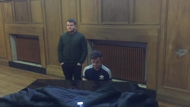 2 Irish men gather at the piano. When they begin singing - it is indescribably beautiful