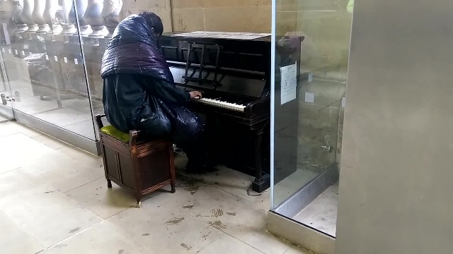 Homeless man sits next to a piano, and left everyone around him totally stunned