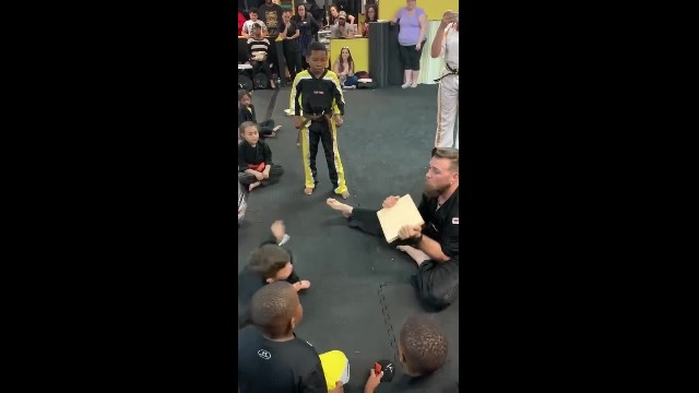 Boy about to give up hears karate classmates cheering, tries again & breaks board!