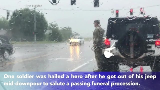 Lone soldier stands in pouring rain to salute fallen soldier's funeral procession