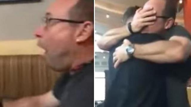 Father leaps out of restaurant booth after seeing marine son disguised as a waiter