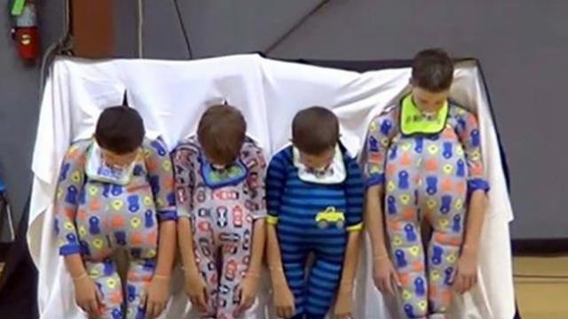 Fifth grade boys reveal onesie costumes at school talent show;