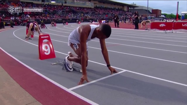 College runner wins 400m hurdles with incredible superman dive