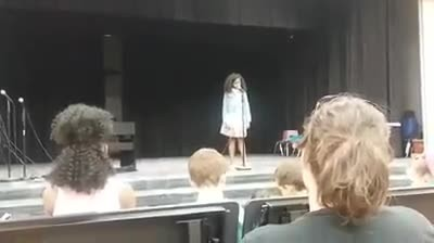 Little girl freezes halfway thru song when suddenly all eyes turn to loud voice in back of room