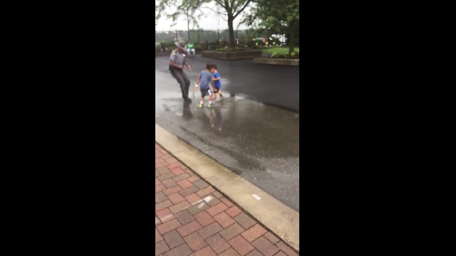 Trooper charges in on kids splashing puddle when mom realizes his intentions & swarms in