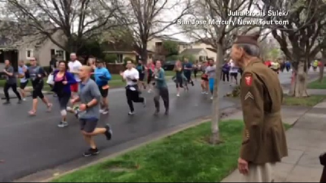 Old Veteran Waves At Marathon Runners To Wish Them Luck. But Keep Your Eyes On The Man In Red