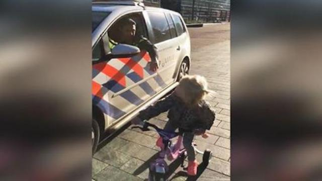 Cop pulls over 3-yr-old on tricycle, then challenges her to cutest street race ever