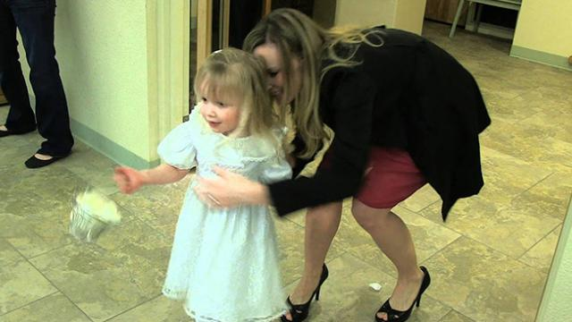 Nervous flower girl can't walk down aisle, but groomsman comes to rescue in hilarious manner
