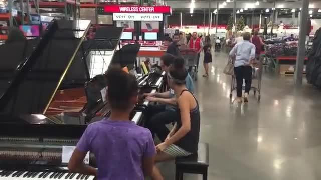She overhears Costco worker playing Adele only to stun shoppers by joining for duet