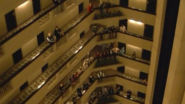 Every year, thousands of young choir students belt the national anthem from their hotel balcony