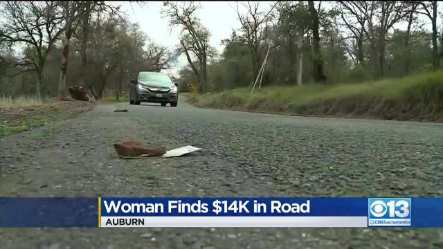 Woman immediately stops car after realizing 'trash' blowing in road was actually $14,000 cash