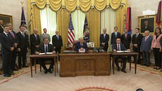 President Trump observes a signing ceremony with the republic of Serbia and the republic of Kosovo