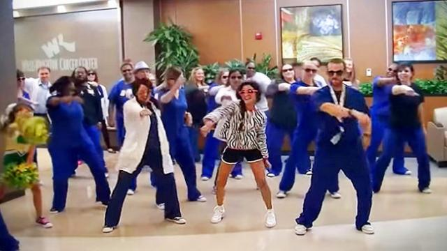Hospital staff surprise 12-year-old girl with her favorite dance and song on last day of treatment
