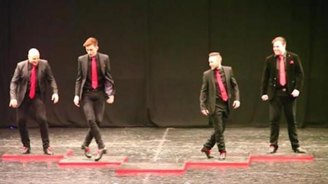 4 men begin to Irish dance, but fifth man storms the stage