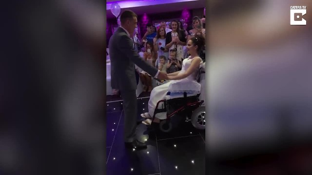 Groom lifts up unsuspecting paralyzed bride out of her wheelchair for 1st dance in his arms