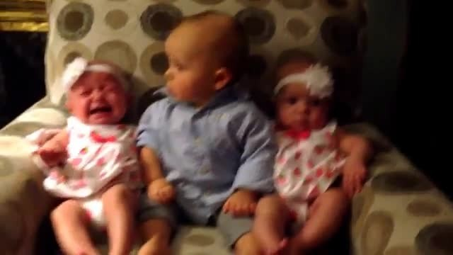 Baby Boy Meets Twins Girls And His Face Says It All - Rumble