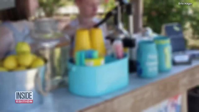 Young sisters use lemonade stand to raise over $4,000 to pay off classmates' student lunch debt