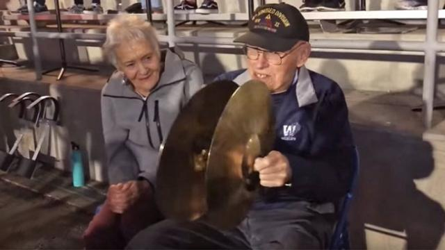 94-yr-old vet dreamed of playing with band so local high school makes it happen.