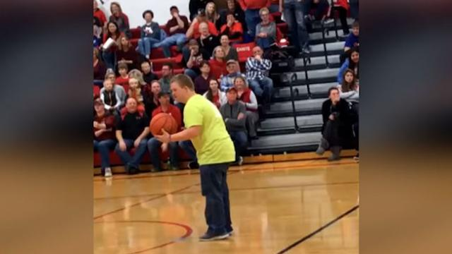 Crowd explodes when teen with Down syndrome nails half-court shot — backwards.