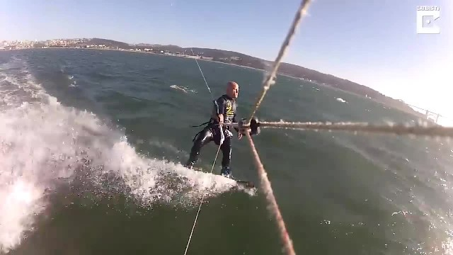 Kiteboarder Andrei Grigoriev accidentally hits a massive humpback whale while kiteboarding off the c