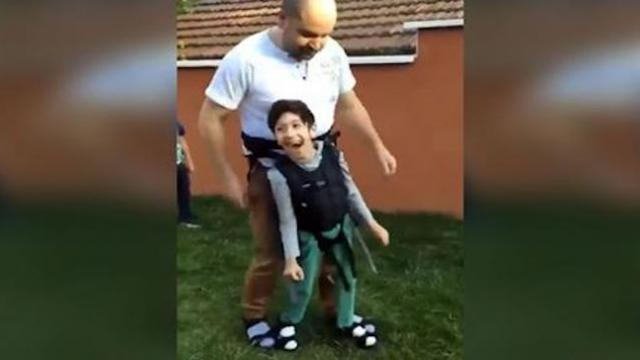 Boy with cerebral palsy lights up playing soccer thanks to dad's special invention