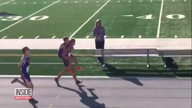 Cross Country Runner Carries Injured Teammate Across Finish Line