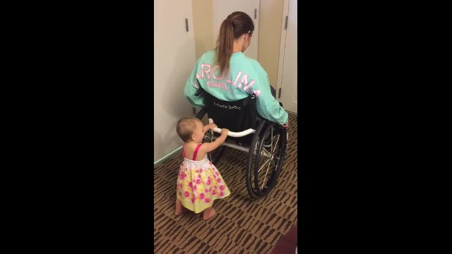 People said paralyzed woman couldn't be a good mom, but she proves everyone wrong