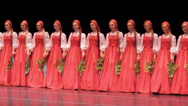 Dancers look like they're floating across the stage in this beautiful folk dance