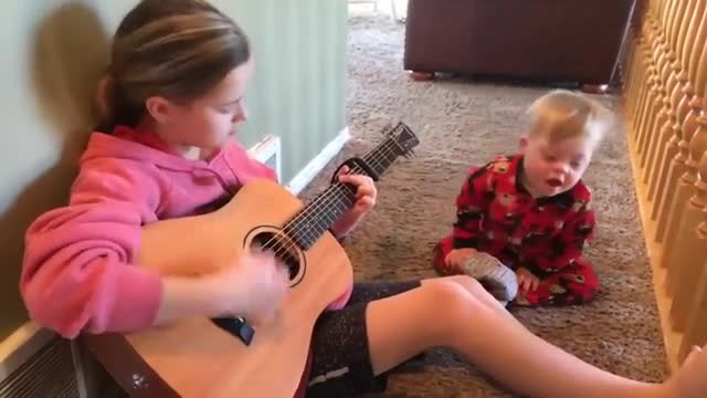 "Little brother with Down syndrome can't speak. Then big sis plays ""You Are My Sunshine"""