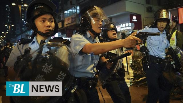Hong Kong Police point guns at citizens as protests ramp up