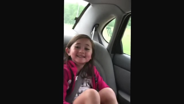 Cuddly cowgirl proudly belts out her favorite Toby Keith song
