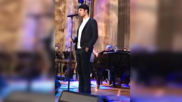 "Andrea Bocelli's son was caught singing swoon-worthy ""Love Me Tender"" cover backstage."