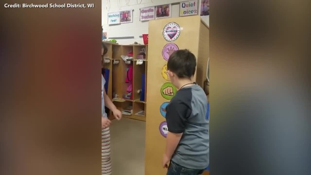 Little boy with Down syndrome appointed classroom greeter, watch his sweet morning routine