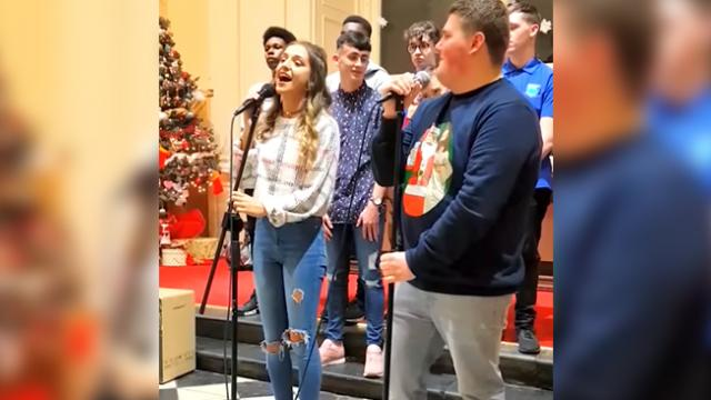 Two teens take stage to sing, but when girl opens her mouth to start, boy is stupefied by her voice